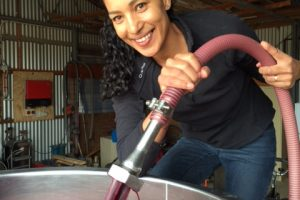 B with hose pumping wine into tank V15